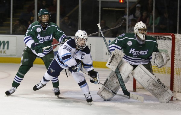 Maine's Joey Diamond takes a stick to the back from Mercyhurst's Randy Cure in the first period at the Cumberland County Civic Center, Friday, Jan. 4, 2013, in Portland, Maine, 2012.