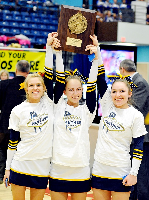 Charlene Wilbur, left, Kelsie Grady, middle, and Jessica Prescott hold of the Maine Principals' Association plaque after Medomak Valley High School won the Class B West Regional Cheering Competition at the Augusta Civic Center on Saturday.