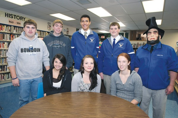 Seven students from Hodgdon High School are preparing for a trip to Washington, D.C. to for the Presidential inauguration in January. Taking part are (seated, from left)Valerie Estabrook, McKensie Palmer and Lacey McQuarrie, (standing, from left) Chris Wallace, Jordan Wilson, Chris Hudson, Ethan Bartlett and  teacher Brian Fitzpatrick, dressed as Abraham Lincoln.