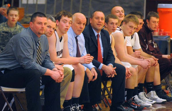Players and coaches on the Nokomis High School bench follow a play during the game against Gardiner High School on Tuesday evening in Newport.
