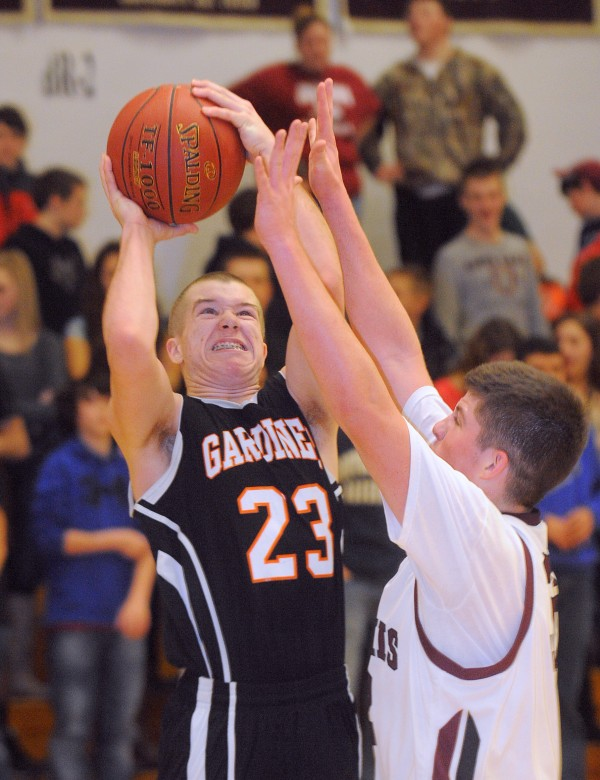 Nokomis High School's Chandler Foss (right) tries to block a shot by Gardiner High School's Josh McKelvey during the first half of the game Tuesday evening in Newport.