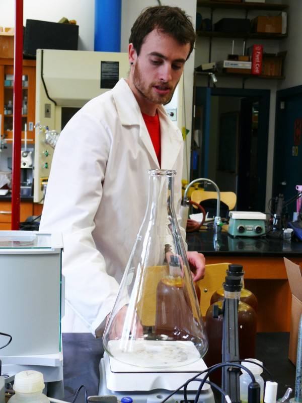 Nick Harris explains one step in the process of turning food waste into fuel for his senior project, Gourmet Butanol.
