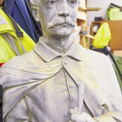 Argyle pipe welder refurbishing statue of soldier in effort to restore Orono Civil War monument