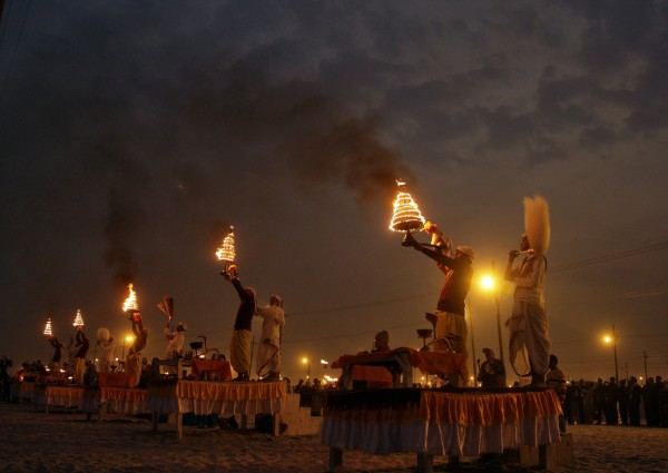 Hindu priests hold oil lamps as they perform evening prayers on the banks of river Ganges during the Kumbh Mela, or Pitcher Festival, in the northern Indian city of Allahabad, on Thursday, Jan. 17, 2013. During the festival, hundreds of thousands of Hindus take part in a religious gathering at the banks of the Ganges. Kumbh Mela will return to Allahabad in 12 years.