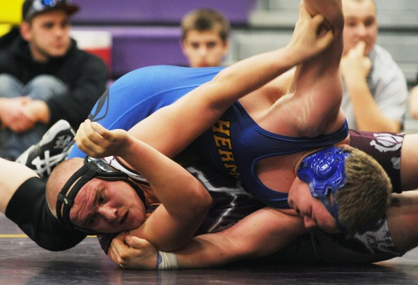Ellsworth's Michael Garland, bottom, and Hermon's Alex Urquhart compete during the finals of Saturday's Penobscot Valley Conference  Championship meet at Bucksport High School. Garland beat Urquhart in the 220-pound class