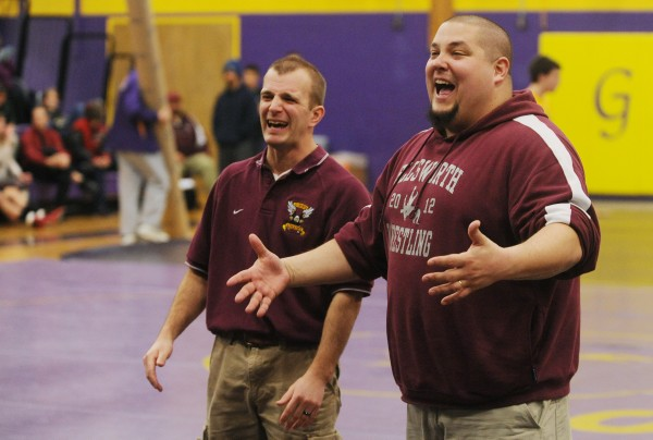 Ellsworth wrestling coaches Travis Hardison, left, and Dan Ormsby react to Ellsworth's Michael Garland defeating Hermon's Alex Urquhart compete during the finals of Saturday's Penobscot Valley Conference Championship meet at Bucksport High School. Garland beat Urquhart in the 220-pound class.