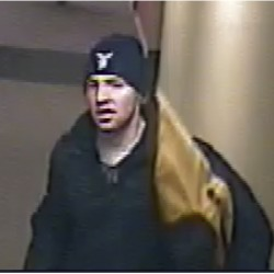 One of the men suspected of robbing a Portland apartment at gunpoint on Friday.