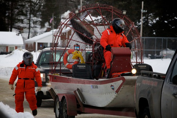 Searchers from the Maine Warden Service unload an airboat as they resume their search for three missing snowmobilers on Rangeley Lake around 8:30 a.m. Thursday, Jan. 3, 2013.