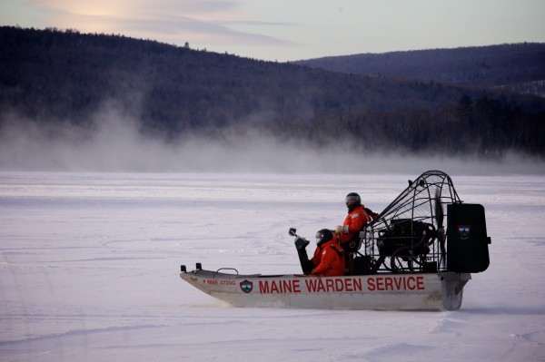 Searchers from the Maine Warden Service resume their search for three missing snowmobilers on Rangeley Lake around 8:30 a.m. Thursday, Jan. 3, 2013.