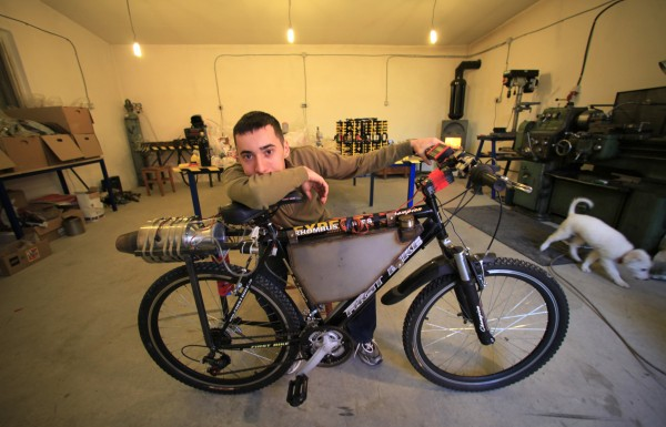 Raul Oaida poses with his bicycle propelled with a self-built jet engine inside a workshop before a road test in the back of his house in Deva, 245 miles outside of Bucharest January 12, 2013. Using his pocket money and sponsorship from various sources, Oaida, 19, made the engine in about 3 years and became the first Romanian to build a jet engine in the country after his compatriot Henri Coanda developed a jet engine for an airplane in 1910 in France, which is said to be the first ever jet engine. Oaida clocked a speed of up to 26 miles per hour with the jet bicycle during today's test.