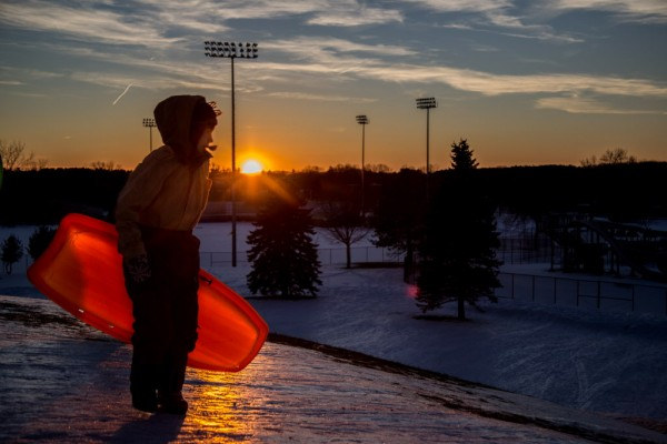 A child prepares for his next sled ride down the hill at Mansfield Stadium on Union Street in Bangor on Thursday, Jan. 10, 2013.