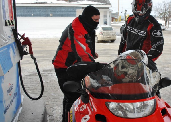 St. John Valley Sledders Andrew Sullivan (left) and Jason Lizotte fuel up before a planned 200-mile trip around Aroostook County on Saturday morning, Jan. 26, 2013. Cold weather and snow have produced some of the best sledding snowmobile officials have seen in Maine for at least a year.
