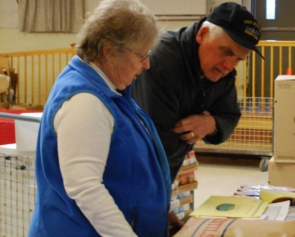 Sybil Riemensnider, left, director of the South Portland Food Cupboard, and volunteer Tony Wagner prepare Thursday, Jan. 24, 2013, for the weekly distribution of food in the basement of St. John the Evangelist Church on Main Street. The food pantry is seeking a new host because of the church's uncertain future.