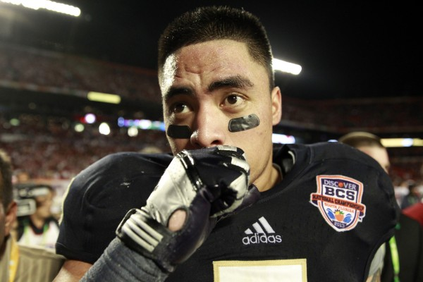 Notre Dame linebacker Manti Te'o fights his emotions as he leaves the field after a 42-14 loss against Alabama in the BCS National Championship game at Sun Life Stadium on Monday, January 7, 2013, in Miami Gardens, Florida.