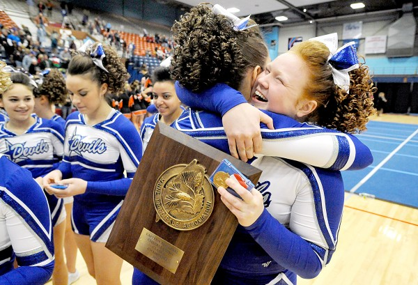 Taylor Pratt, right, celebrates with Erika Thibault after Lewiston High School won the Class A East Regional Cheering Competition at the Augusta Civic Center on Saturday.