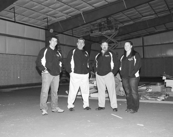 Four of the Sluggers team pose in their under-construction facility on the Acme Road in Brewer. From left is Travis Thome, director of baseball; Darrell Pluard, general manager; Karl Ward, owner; and Terren Hall, director of softball. The group has an impressive array of over two dozen coaches ready to train kids in baseball and softball, starting Feb. 2 when Sluggers opens.