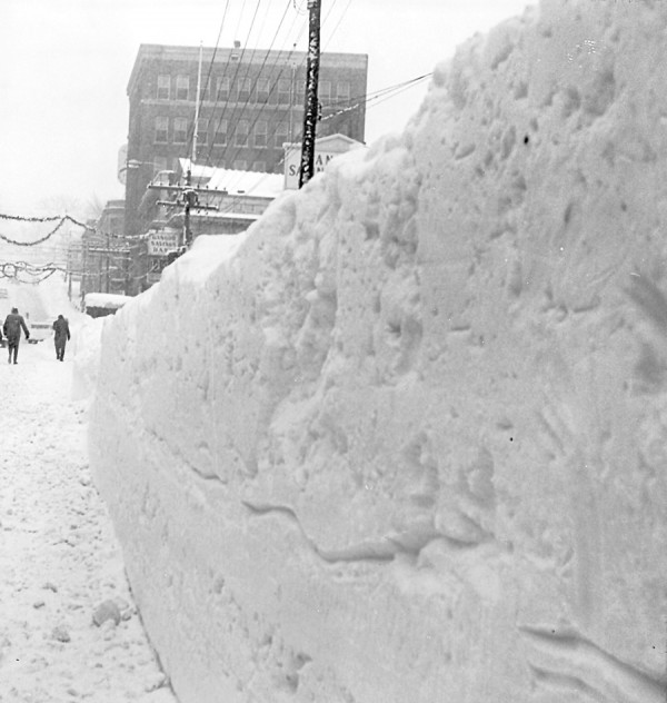 Efforts to remove snow from downtown Bangor streets showed some progress on Jan. 1, 1963 when this photo was taken from a spot approximately outside today's Hammond Street Seniors Center. The photographer was facing State Street Hill (beyond the pedestrians); Bangor Savings Bank is the first building on the right.