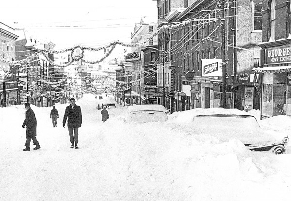 With Main Street plugged by snow, only pedestrians could move in downtown Bangor not long after the Dec. 30, 1962 blizzard. The photographer was standing in the street near today's shuttered Greyhound station and looking toward the distant intersection of Main and Hammond streets. Hodsdon Street is to the right of the Schlitz sign; Freese's Department Store is the tall, light-colored building on the right, about halfway toward the Hammond-Main street intersection.