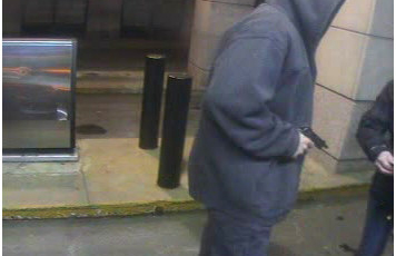 Portland police are seeking this man, who robbed a woman at gunpoint at an ATM Thursday night.