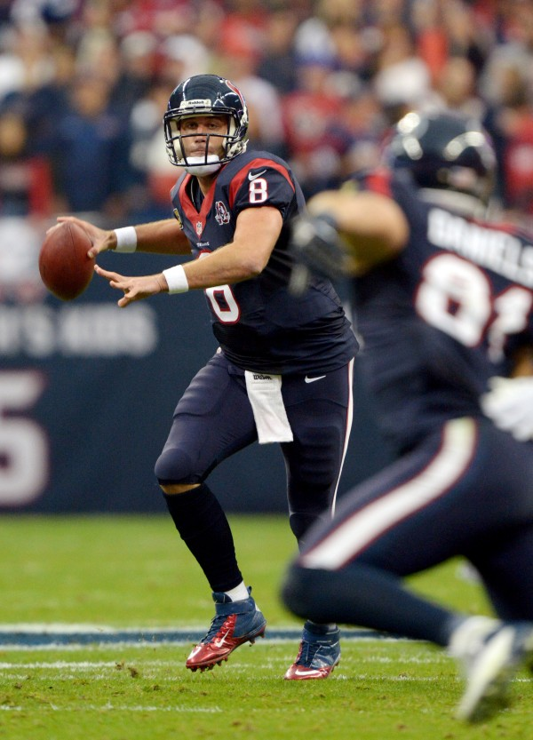 Houston Texans quarterback Matt Schaub (8) throws a pass to tight end Owen Daniels (81) against the Cincinnati Bengals in an AFC wild card playoff game at Reliant Stadium on Jan. 5, 2013.