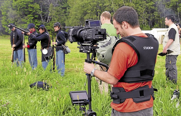 "Todd Eastman, a faculty member at the New England School of Communications in Bangor, films footage with a Steadicam last August during a Civil War re-enactment held at the Good Will-Hinckley School in Fairfield. He shot the footage for a Maine Public Broadcasting Network documentary titled ""Sixteenth Maine at Gettysburg."""