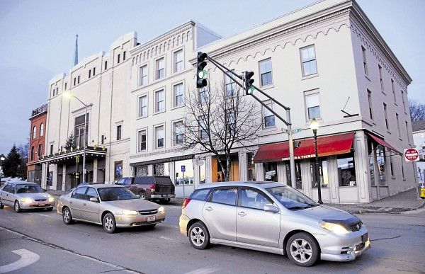 The dawn light has not quite illuminated the Bangor Opera House or traffic awaiting a green light at Main and Water streets about 7 a.m. on a clear January weekday.