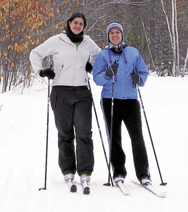 Sisters Annie Treworgy (left) and Robin Pellerin (right) enjoy a day of cross country skiing on the Treworgy Family Orchards cross-country trails in Levant.