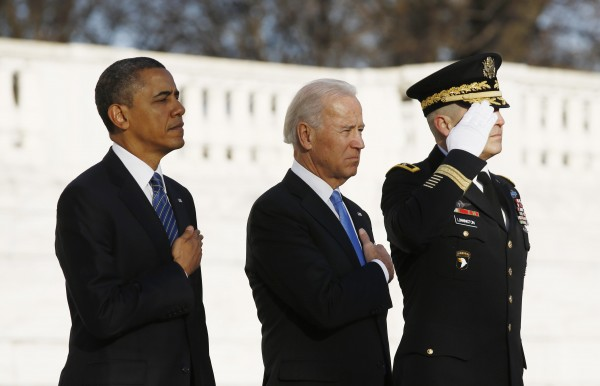 President Barack Obama and Vice President Joe Biden are pictured as they listen to taps being played after laying a wreath at the Tomb of the Unknown Soldier at Arlington National Cemetery near Washington, Jan. 20, 2013. Obama will take the official oath of office in a small, private ceremony at the White House on Sunday, setting a more subdued tone for his second inauguration than his historic swearing-in four years ago. Following a wreath-laying ceremony at Arlington National Cemetery, Obama will be sworn in at the White House at 11:55 a.m.