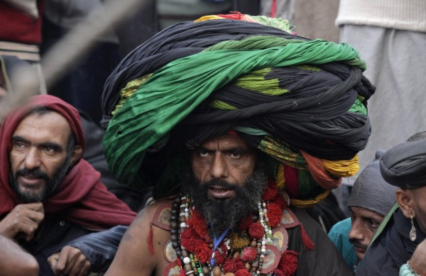 A devotee wears a big turban made from colorful sheets of cloth as he sits outside the shrine of Muslim Sufi Saint Data Ganj Bakhsh on his death anniversary in Lahore on Jan. 2, 2013. Devotees started a three-day celebration of the 969th festival of Hazrat Ali Bin Usman popularly known as Data Gunj Bakhsh.