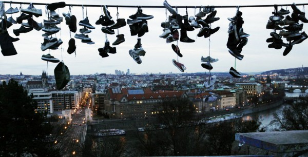 Shoes hang on a power line at Letna Park overlooking Prague early Jan. 2, 2013. Czech teenagers, who skateboard at the park, throw their damaged and unwanted shoes over the wire for fun at the city's main skating hangout, once the site of a monument to former Soviet leader Josef Stalin.