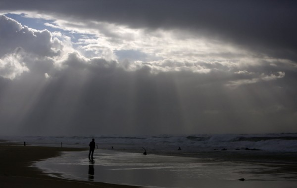 A person stands on the shores of the Mediterranean Sea on a stormy day at Nitzanim beach, near the southern city of Ashkelon on Jan. 7, 2013.