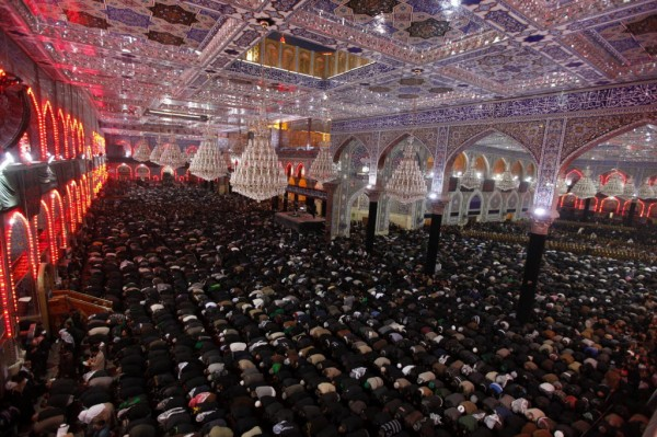 Shi'ite pilgrims pray at the Imam Hussein shrine during the Shi'ite religious ceremony of Arbain in the holy city of Kerbala, 50 miles southwest of Baghdad on Jan. 2, 2013.