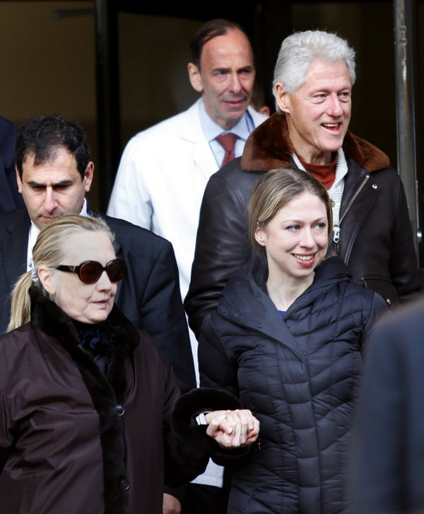 U.S. Secretary of State Hillary Clinton (left) leaves New York Presbyterian Hospital with husband, Bill (top right), and daughter, Chelsea (right), in New York, Jan. 2, 2013. The secretary of state, who has not been seen in public since Dec. 7, was revealed on Sunday evening to be in a New York hospital under treatment for a blood clot that stemmed from a concussion she suffered in mid-December.