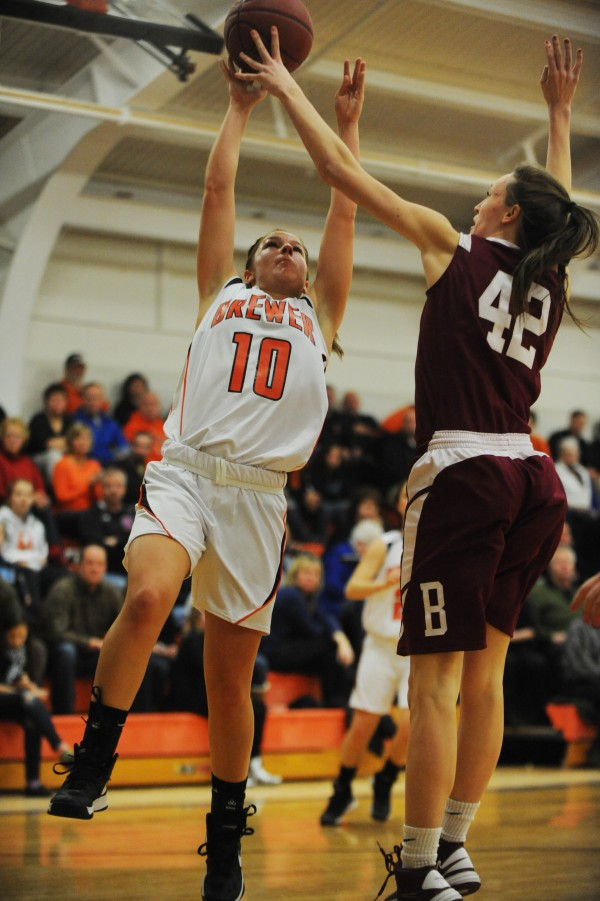 Brewer's Alexa Grindle gets her shot blocked by Bangor's Mary Butler during first half action at Brewer.