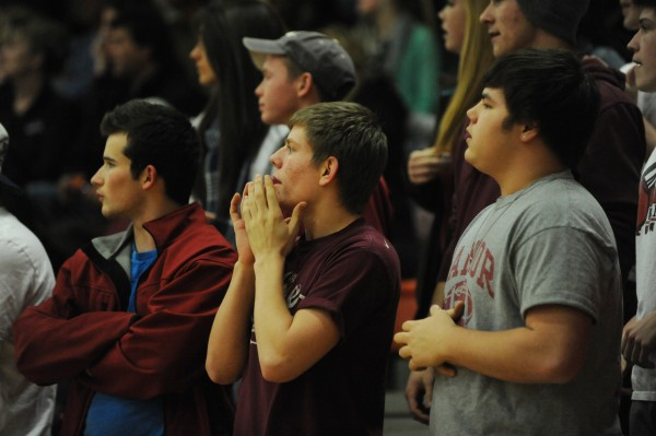 A member of the Bangor High School student body reacts to a play on the floor as Bangor High girls take on Brewer at Brewer on Monday.