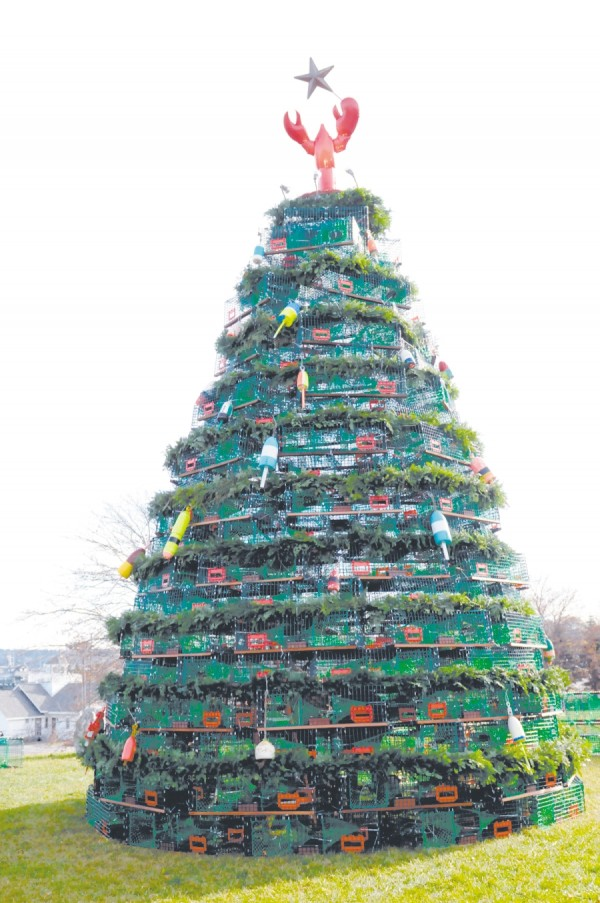 The finished tree, with 480 feet of garland, 125 lobster buoys, and lights, stood 35 feet tall and weighed over 3 tons.