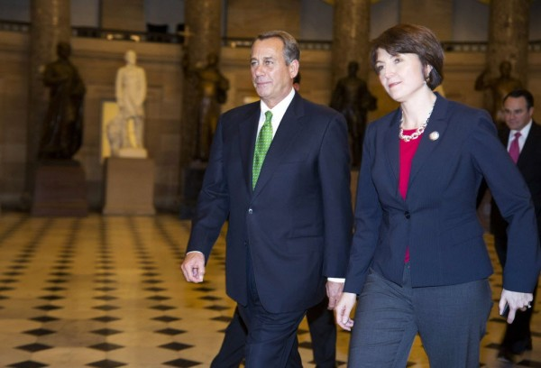 Speaker of the House John Boehner (R-OH) walks with Representative Cathy McMorris Rodgers (R-WA) for a vote on resolving the &quotfiscal cliff&quot on Capitol Hill in Washington January 1, 2013.