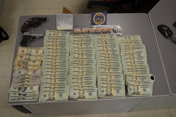 Two handguns, $2,100 in cash, more than $11,000 worth of heroin, and 40 grams of an unidentified substance were among items police seized Wednesday night in Ellsworth during a drug bust at a home on Water Street. Matthew Wright, 33, was arrested as a result on a charge of aggravated trafficking in drugs, according to Maine Drug Enforcement Agency.