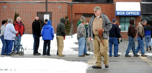 Robert Luce of Holden leaves a gun show at the Augusta Civic Center in Augusta on Saturday. Luce purchased a .22-caliber revolver while at the show.