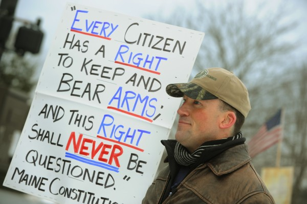 Second Amendment protesters, including Michael Hein, gather near the capitol building in Augusta on Saturday.