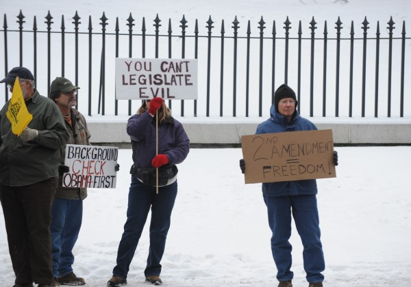 Second Amendment protesters gather near the capitol building in Augusta on Saturday.
