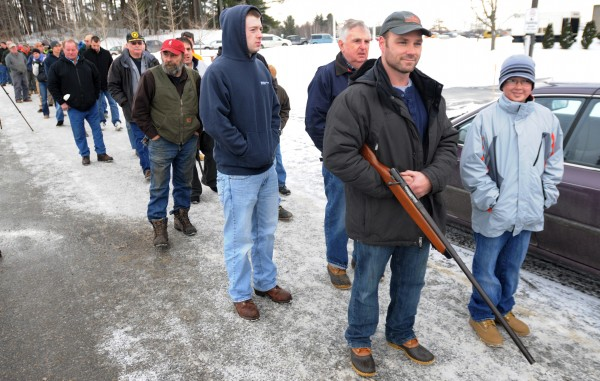 Jason Davis of Greene stands in line at a gun show at the Augusta Civic Center in Augusta on Saturday. Davis was looking to trade in the shotgun he has had since he was 10 in order to purchase a small handgun his wife can use for protection.
