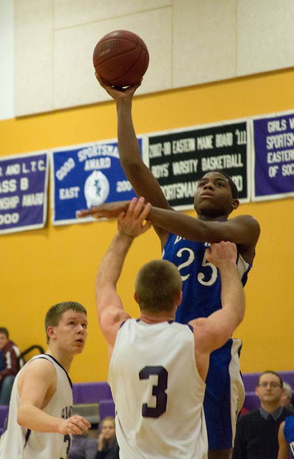 Lewiston's Matt Hudson shoots over Hampden's Brian Fickett during their game on Friday.