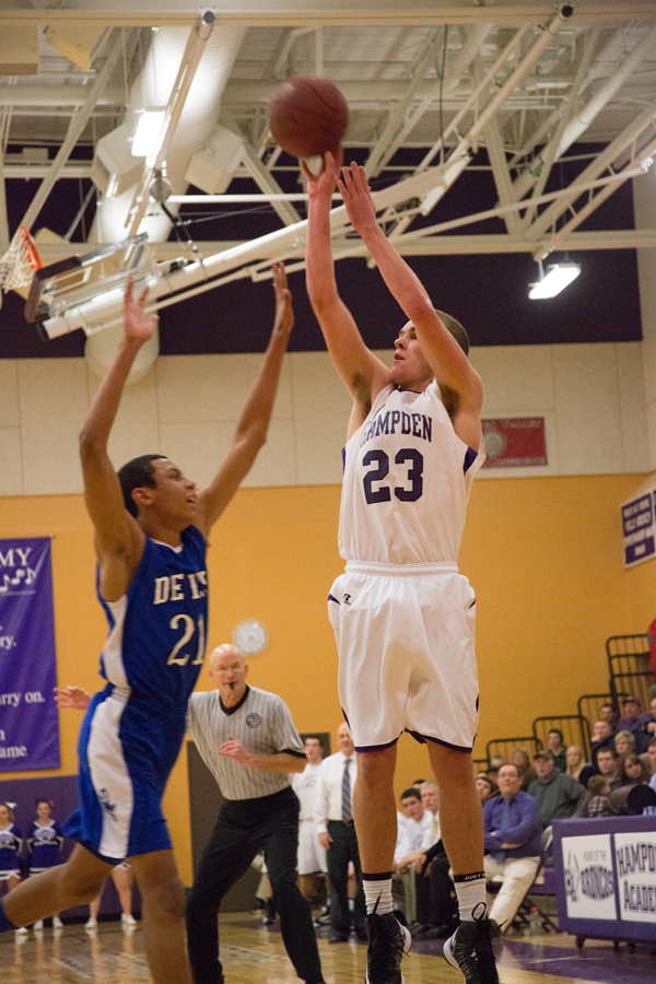 Hampden's Zachary Gilpin attempts a three-point shot over Lewiston's Isaiah Harris on Friday.