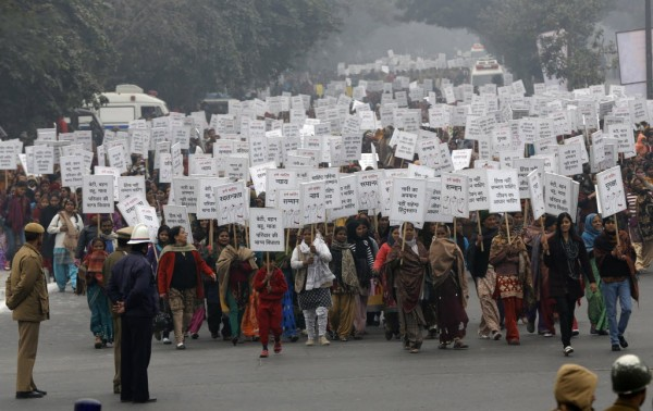 Women hold placards as they march recently during a rally protesting for justice and security for women, in New Delhi. A rape last month of a physiotherapy student on a moving bus and her death on Dec. 28, 2012 triggered a national debate about how to better protect women in India.