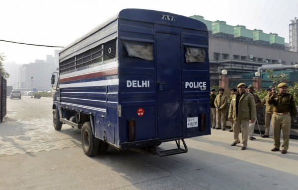 A police van carrying five men accused of the gang rape and murder of an Indian student arrives at a court in New Delhi on Jan. 7