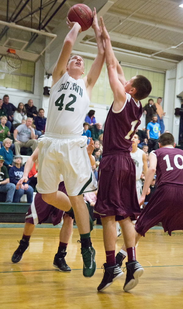 Old Town's Adam Richardson, left, attempts a lay up against Ellsworth's Josh Bean.