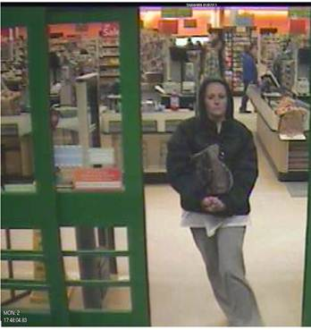 Surveillance images released by the Bangor Police Department Tuesday show a woman leaving Shaw's Supermarket on Main Street with a large pocketbook in her hands.