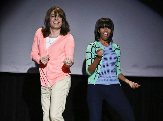 Jimmy Fallon dances with first lady Michelle Obama during an appearance on &quotLate Night with Jimmy Fallon,&quot Friday.
