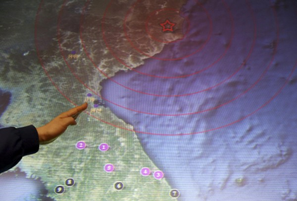 An official points to North Korea's Kilju, where the North conducted a nuclear test, on a map on a screen at the Korea Meteorological Agency in Seoul on Feb. 12, 2013. North Korea conducted its third nuclear test on Tuesday in defiance of existing U.N. resolutions, angering the U.S. and Japan and prompting its only major ally, China, to call for calm.